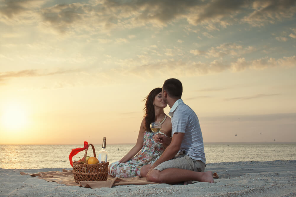 Photo of a couple on a beach date.