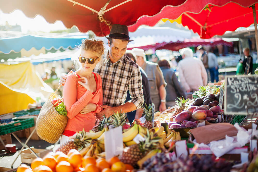 Photo of a Smiling Couple at the Lincoln City Farmer's Market.